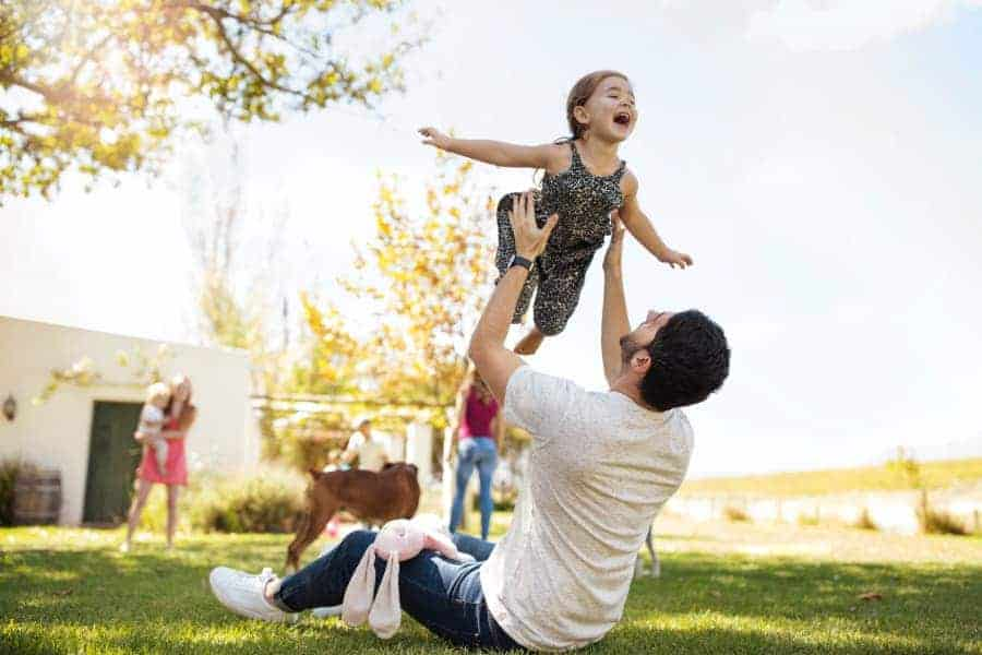 Man Lifting Daughter